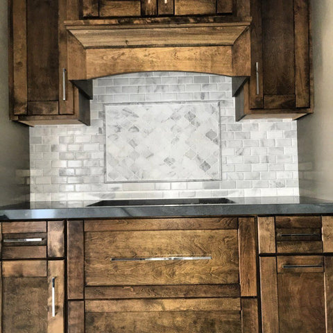 Carrara Venato Marble Beveled Subway Tile and Arabesque Lanterns Stovetop Backsplash