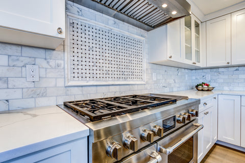 Carrara Marble Subway Tile and Basketweave Tile Feature Over Stove