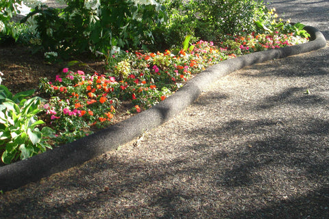 Image of rubber edging border shaper installed garden path