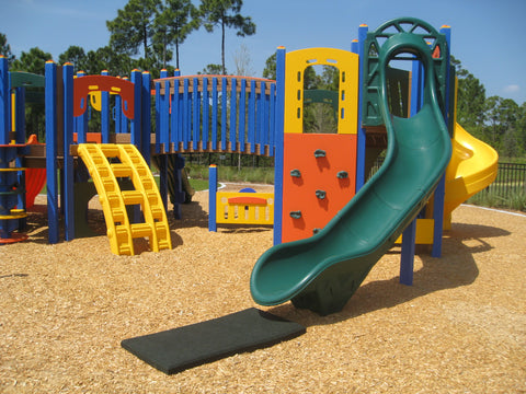 Image of slide mat with playground equipment