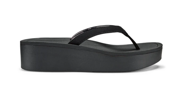 OLUKAI PI'O LUA WOMEN'S WEDGED SANDAL IN BLACK/BLACK