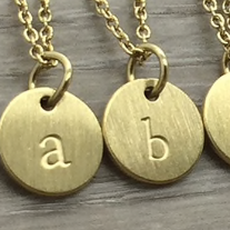 FAB Accessories Lowercase Letter Necklace in Gold