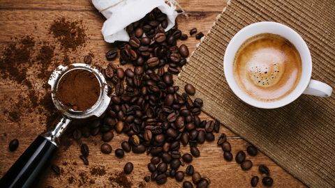 photo of espresso portafilter coffee beans and an espresso coffee drink