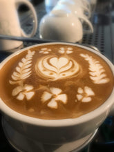 Photo of Latte Art in a white cup