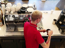 Photo of Barista making an espresso drink