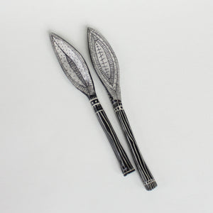 two pointy leafy shaped spoons