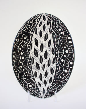 large oval serving platter vertical on white background