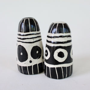 Pair of black and white salt and pepper shakers with circles and stripes