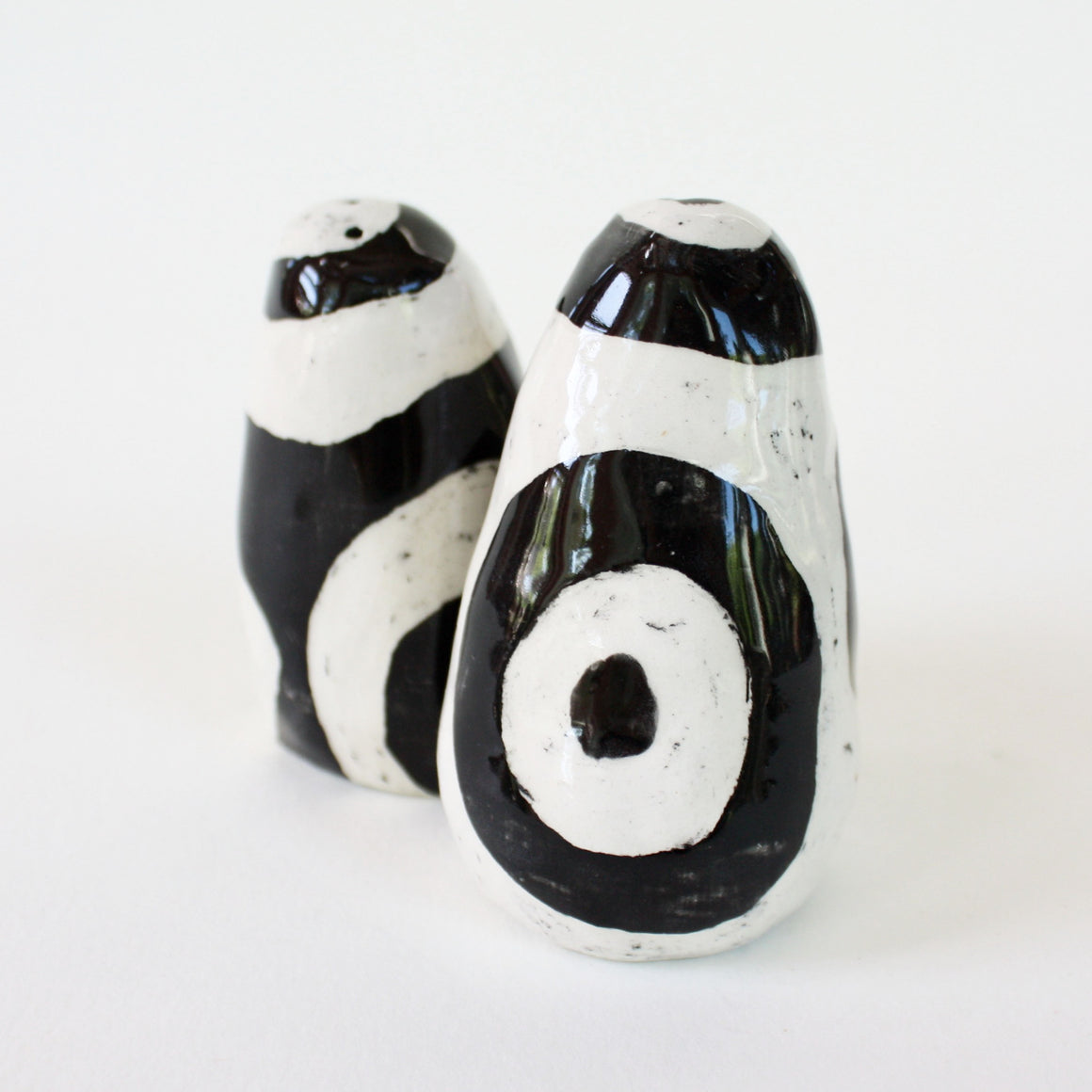Pair of black and white salt and pepper shakers with large circle