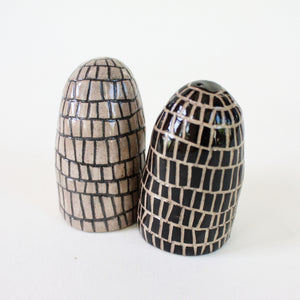 Pair of salt and pepper shakers with brick pattern