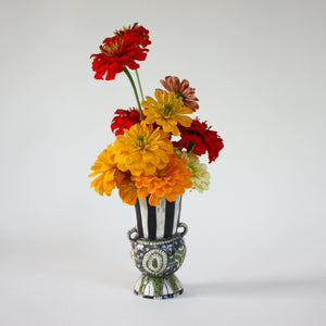 small sculptural vase with flowers