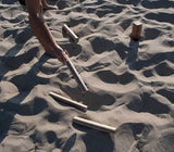 Playing Kubb Game in Sand