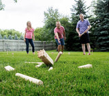 Playing Kubb Game in the Yard