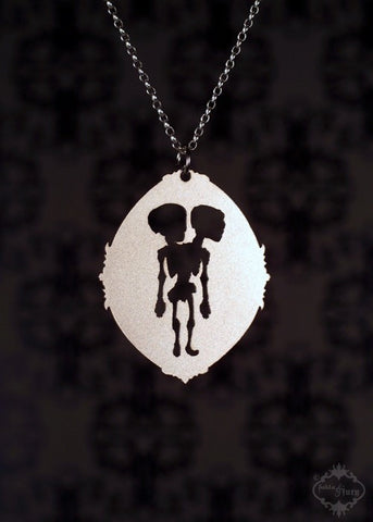 Conjoined Twin Skeleton Necklace in stainless steel