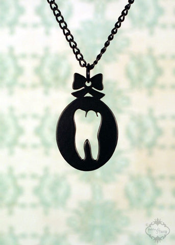 Sweet Tooth Cameo Bow Necklace in black stainless steel