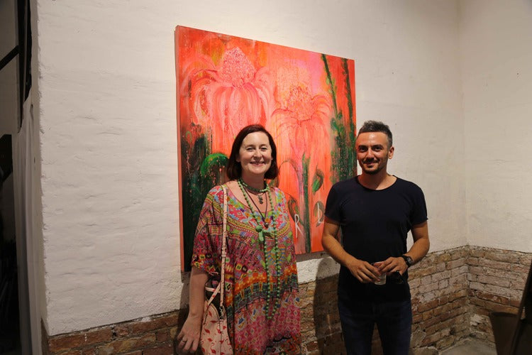 Clare Haxby with Luca Curci, exhibition curator