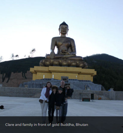 Clare and family in front of gold Buddha, Bhutan