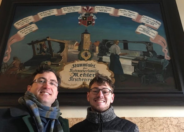 Robert and Maximilian Mehler in front of family tree painting
