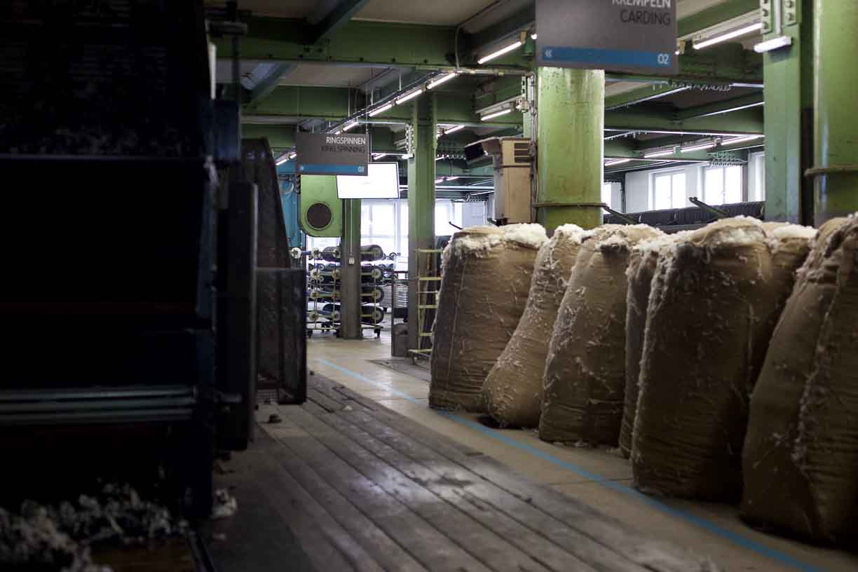 bales of raw merino wool at a mill in the Alps