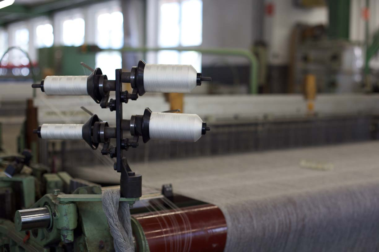 close up of a spindle of yarn being used as the weft in a loden fabric in Austria