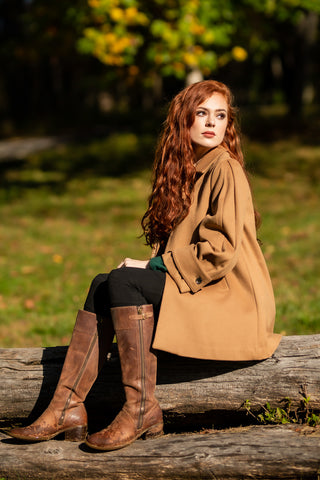 young woman wearing Robert W. Stolz Loden Coat with horseback riding boots