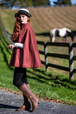 little red riding hood wearing cherry red Robert W. Stolz loden poncho at horse farm in Potomac, MD