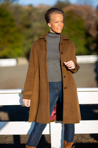 model wearing smooth brown cashmere Robert W. Stolz loden coat in Potomac Maryland