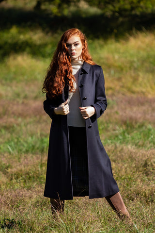 beautiful young woman wearing midnight navy Robert W. Stolz full length loden coat