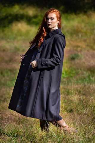 young lady wearing Robert W. Stolz long loden wool coat