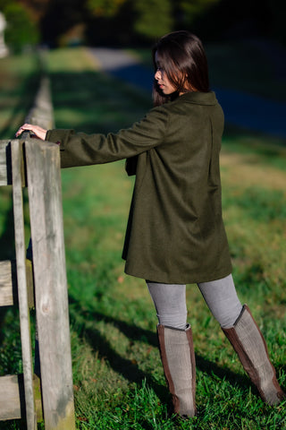 young woman wearing loden green Robert W. Stolz loden coat at horse farm in Maryland