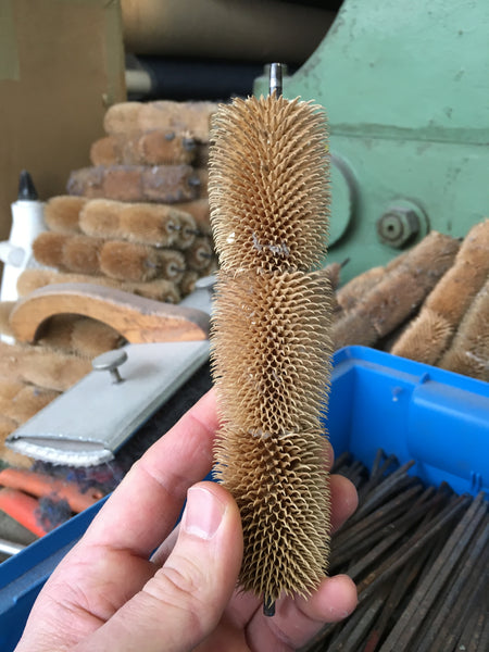 thistle cones on a spindle for brushing loden wool fabric
