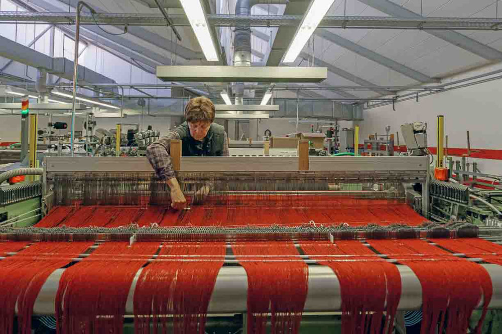women tending a loom at Germany's oldest mill