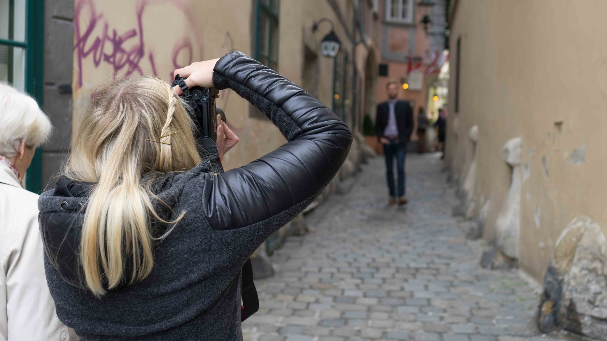 Photographer Astrid Schweyer taking a picture in the old city of Vienna on October 8th 2016 for Robert W. Stolz jacket photo shoot