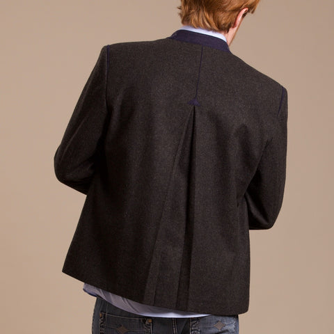 the backside of a Robert W. Stolz austrian loden jacket with traditional arrow pleat