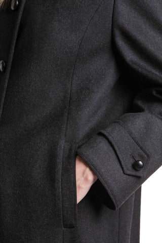 cuff and pocket detail shot on a women's long wool overcoat