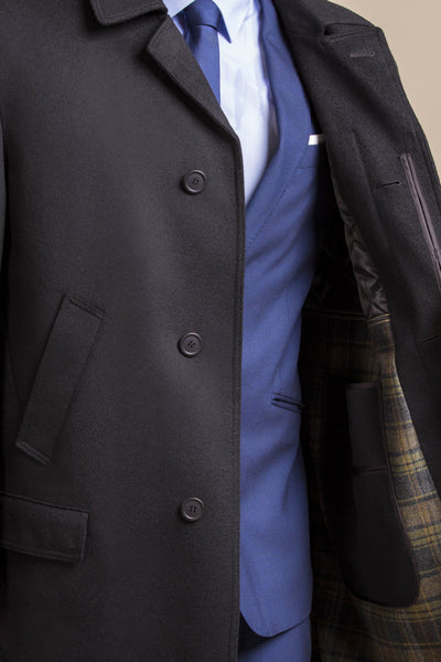 a close up view of a 30 year old man wearing an austrian himalaya loden wool overcoat