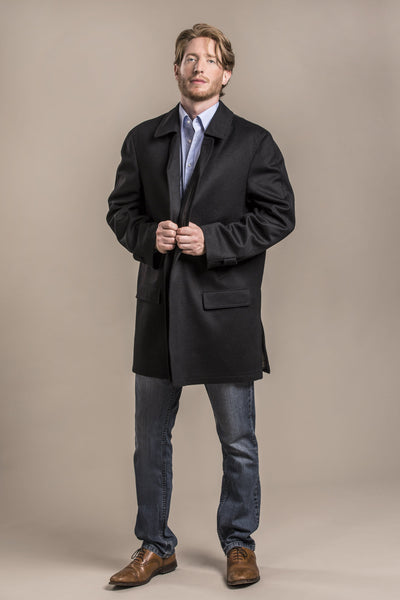 a profile view of a 30 year old man wearing an austrian himalaya loden wool overcoat