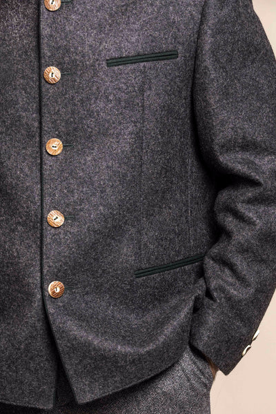 a close up view of a 30 year old man wearing an austrian loden wool jacket