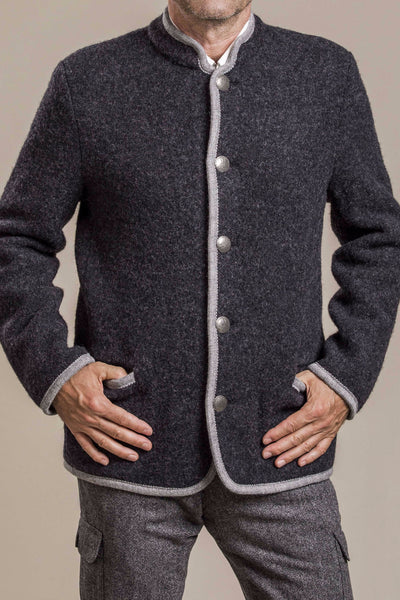 50 year old man wearing a buttoned original Austrian boiled wool walk jacket