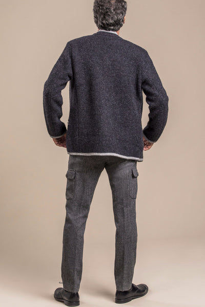 The backside view of 50 year old man wearing an original Austrian boiled wool walk jacket