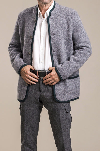 a full frontal view of a 50 year old man wearing a gray traditional austrian boiled wool jacket