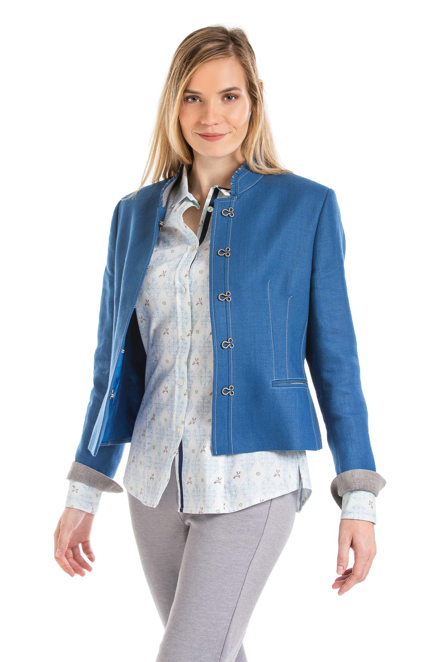young blonde women wearing a blue Austrian linen jacket