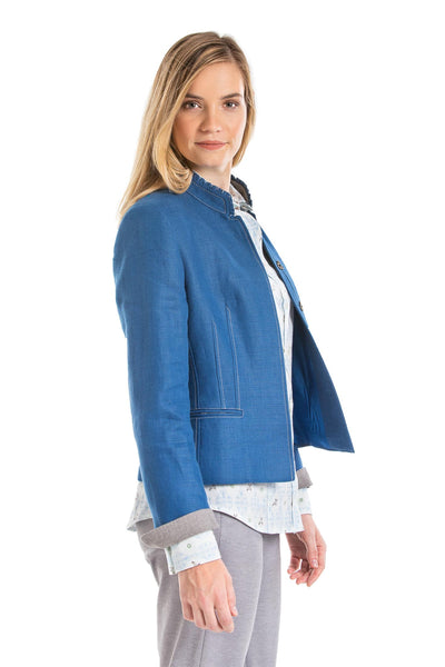 young blonde women wearing a blue Austrian linen riding jacket
