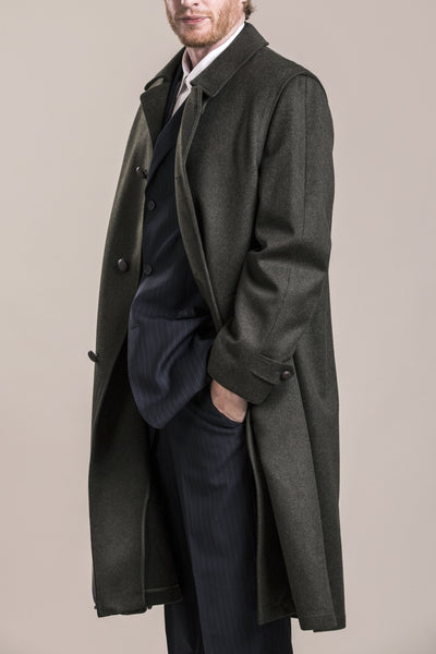 the profile view of a 30 year old man wearing a traditional austrian loden wool coat