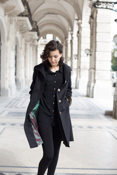 female model in a charcoal color loden wool coat in Vienna