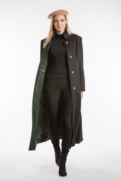front view of a blonde women wearing a long loden coat from Robert W. Stolz