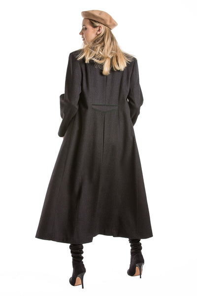 back view of a blonde women wearing a long loden coat from Robert W. Stolz