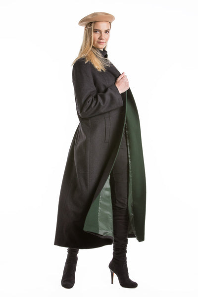 blonde women wearing a long loden coat from Robert W. Stolz