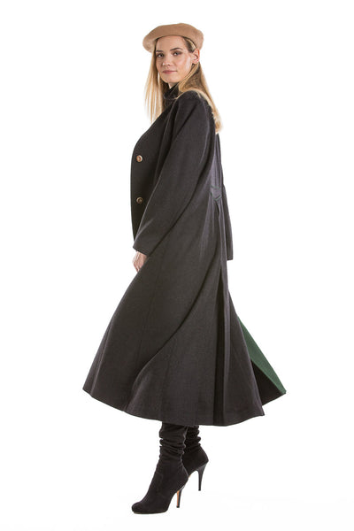 side view of a blonde women wearing a long loden coat from Robert W. Stolz