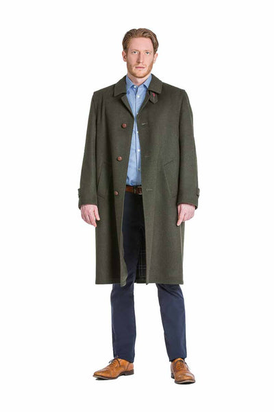 young man wearing a Robert W. Stolz green loden coat with removable zip out lining